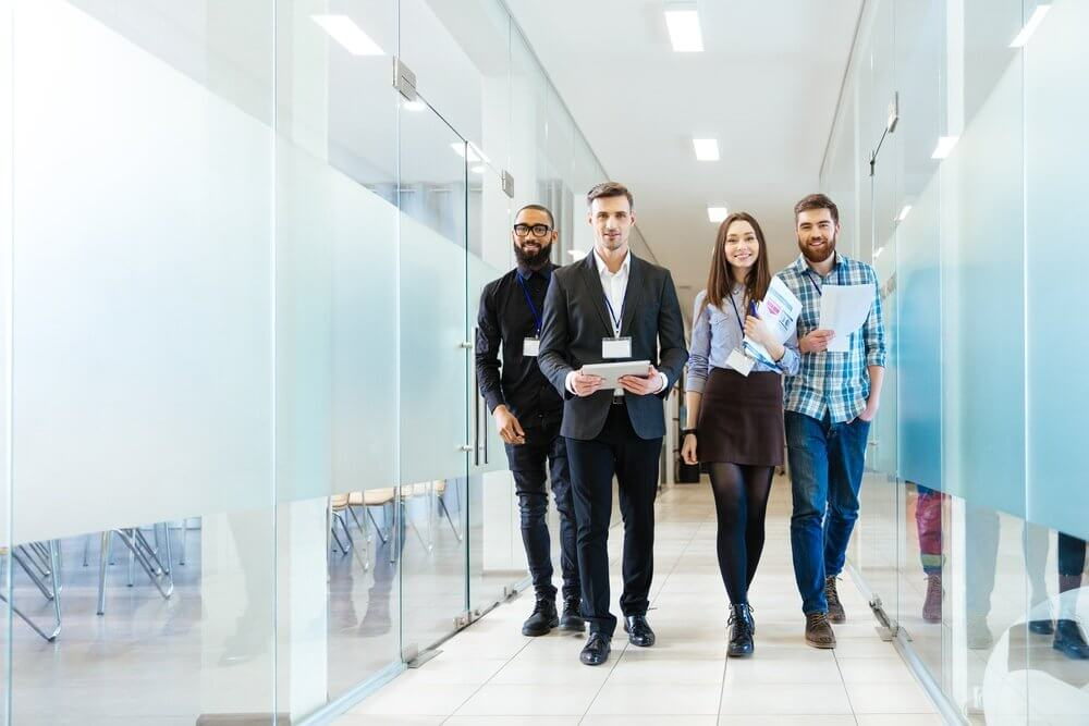 Group of happy young facility managers workplace unplugged