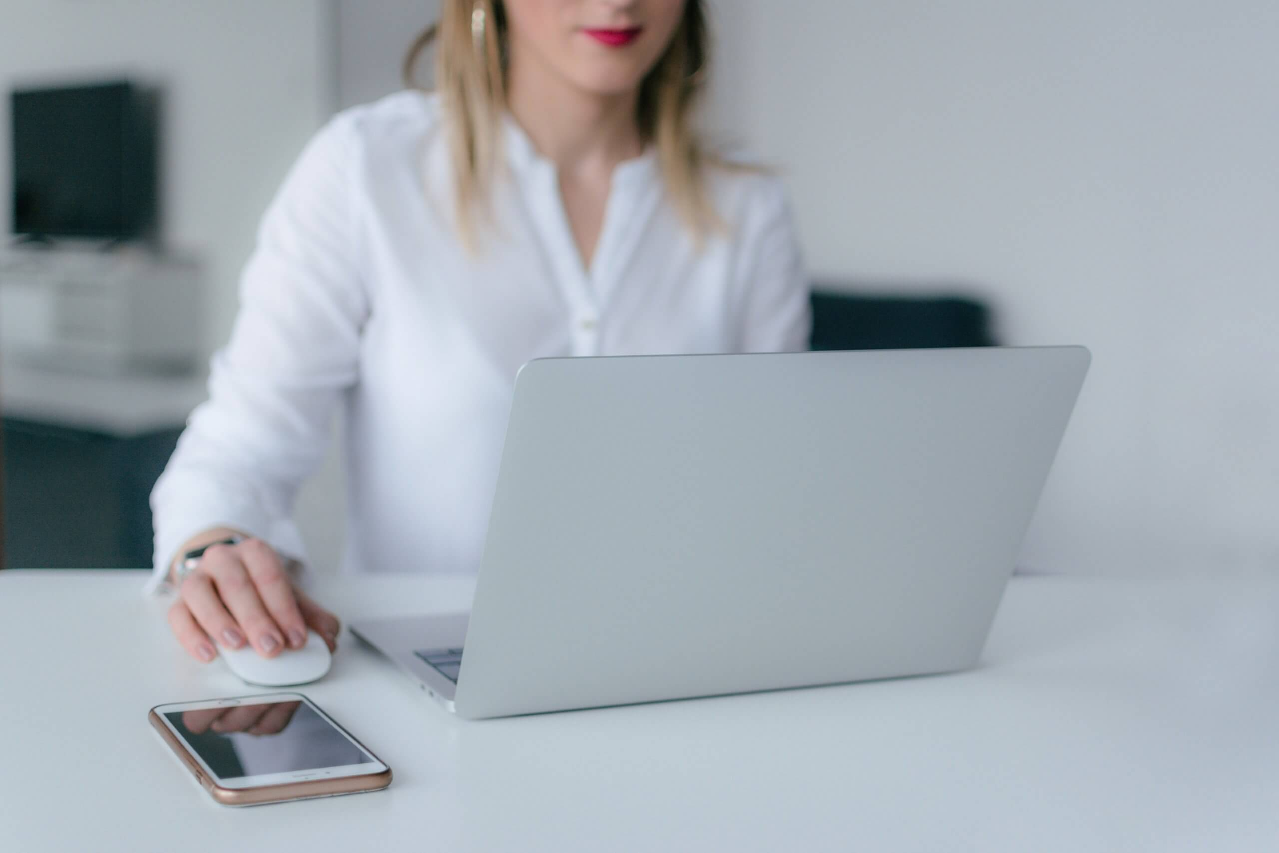 woman using a laptop at a desk