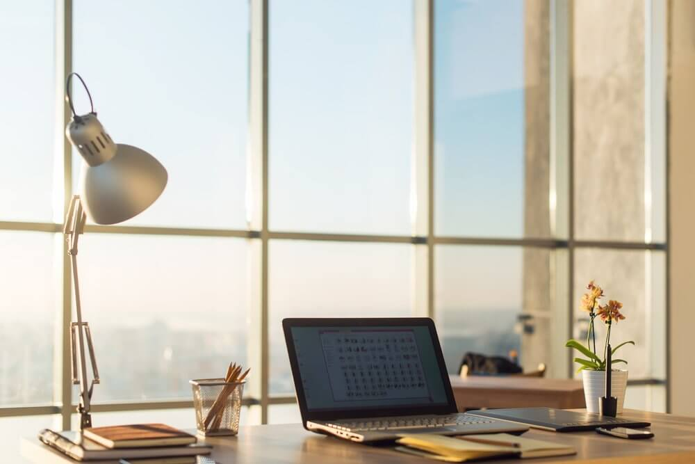 office desk and lamp by window