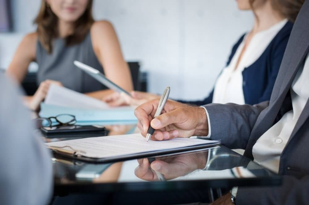 Business people taking notes in conference room