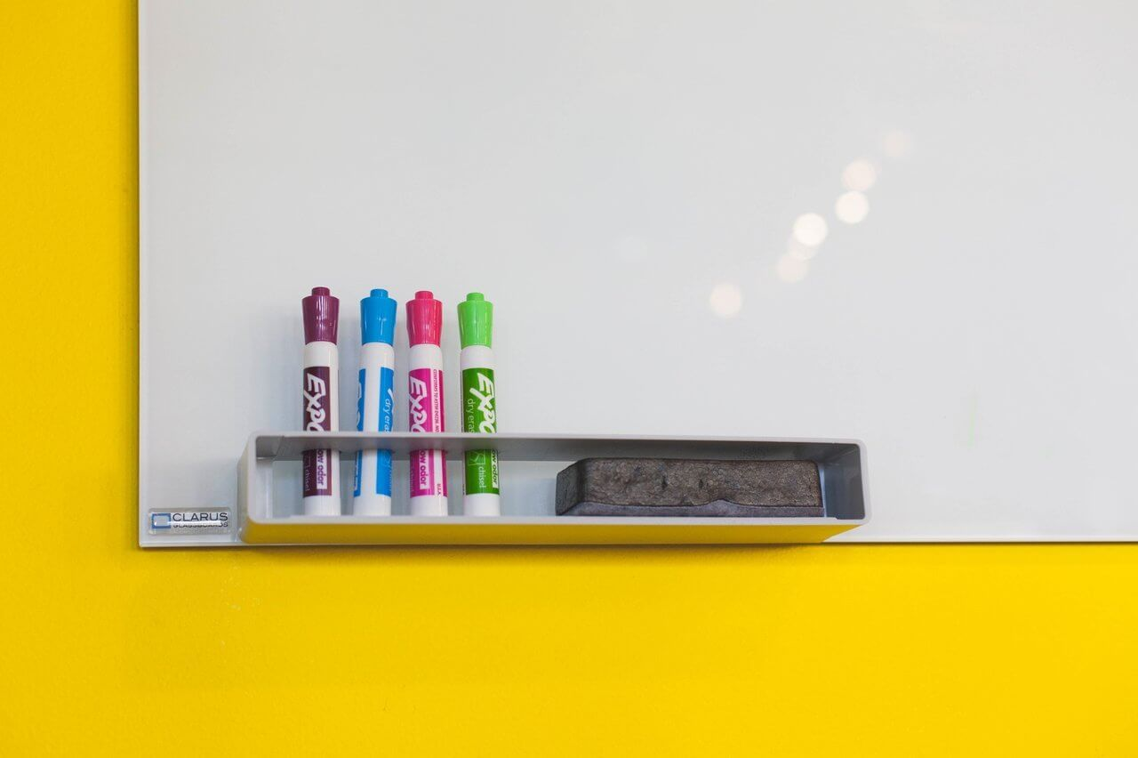 whiteboard with colorful markers